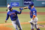 New York Mets' Robinson Cano (24) celebrates with Pete Alonso (20) after scoring with Yoenis Cespedes on a two-run single by Amed Rosario during the second inning of a baseball game against the Boston Red Sox, Tuesday, July 28, 2020, in Boston. (AP Photo/Michael Dwyer)