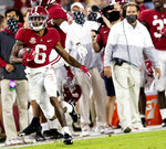 Alabama wide receiver DeVonta Smith (6) heads for a long gain as coach Nick Saban watches during the team's NCAA college football game against Kentucky on Saturday, Nov. 21, 2020, in Tuscaloosa, Ala. (Mickey Welsh/The Montgomery Advertiser via AP)
