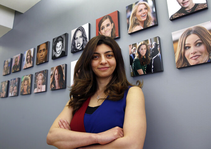 FILE - This April 23, 2018 file photo shows Rana el Kaliouby, CEO of the Boston-based artificial intelligence firm, Affectiva, poses in Boston.  El Kaliouby has  a new job, deputy CEO of Smart Eye — after the Swedish eye-tracking company bought Affectiva for $73.5 million in June 2021. Carmakers are looking to companies like Smart Eye as they brace for new safety rules and standards around the world that could require dashboard cameras to detect dangerous driver behavior in semi-autonomous vehicles(AP Photo/Elise Amendola, File)