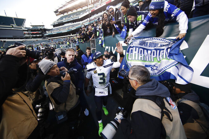 Seattle Seahawks' Russell Wilson greets fans after an NFL football game against the Philadelphia Eagles, Sunday, Nov. 24, 2019, in Philadelphia. Seattle won 17-9. (AP Photo/Matt Rourke)
