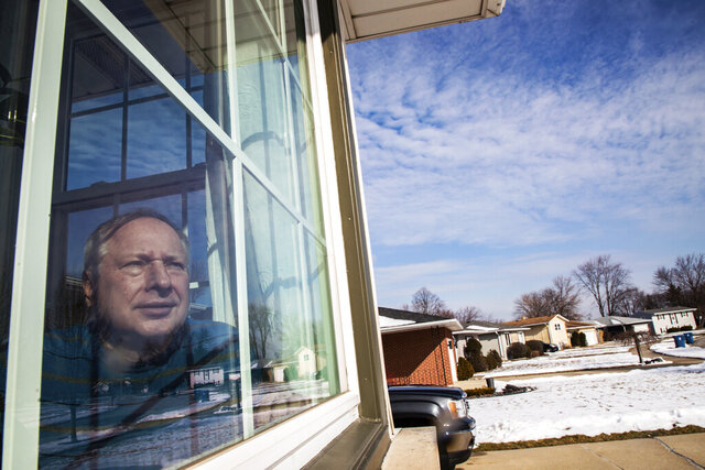 In this Feb. 11, 2020, photo, Ken Zurek, 63, poses for a photo at his home in Highland, Ind. Zurek and his wife arrived in China days before news broke of the coronavirus. They cut their trip short because of the virus and decided to self quarantine themselves in their Highland home for 15 days, just as an extra precaution. (Zbigniew Bzdak/Chicago Tribune via AP)