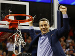 FILE - In this March 9, 2019, file photo, Virginia head coach Tony Bennett holds a piece of the net after a victory over Louisville after an NCAA college basketball game in Charlottesville, Va. Bennett was named the ACC Conference Coach of the Year for the second straight year, Tuesday, March 12, 2019. (AP Photo/Steve Helber, File)