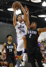 Utah Jazz's Grayson Allen (24) drives into Portland Trail Blazers' Wade Baldwin IV during the second half of an NBA summer league basketball game Saturday, July 7, 2018, in Las Vegas. (AP Photo/John Locher)