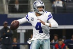 Dallas Cowboys quarterback Dak Prescott (4) looks koto throw against the Washington Redskins during the first half of an NFL football game in Arlington, Texas, Sunday, Dec. 15, 2019. (AP Photo/Ron Jenkins)