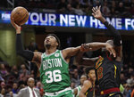 Boston Celtics' Marcus Smart (36) drives against Cleveland Cavaliers' Deng Adel (32) during the first half of an NBA basketball game Tuesday, Feb. 5, 2019, in Cleveland. (AP Photo/Tony Dejak)