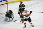 Florida Panthers right wing Noel Acciari, right, celebrates and Minnesota Wild defenseman Ryan Suter (20) and goalie Alex Stalock react after Acciari scored the game winning goal with a tip in shot with six seconds left in the third period of an NHL hockey game Monday, Jan. 20, 2020, in St. Paul, Minn. The Panthers won 5-4. (AP Photo/Craig Lassig)