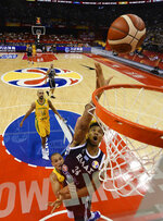 In this photo released by Xinhua News Agency, Giannis Antetokounmpo of Greece puts up a shot during their group stage game against Brazil in the FIBA Basketball World Cup in Nanjing in eastern China's Jiangsu province, Tuesday, Sept. 3, 2019. (Li Xiang/Xinhua via AP)