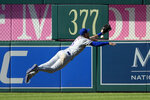 New York Mets left fielder Jeff McNeil (6) leaps but cannot get to a ball that went for a ground rule double for Washington Nationals' Carter Kieboom during the seventh inning of the first baseball game of a doubleheader, Saturday, Sept. 4, 2021, in Washington. The Mets won 11-9 in extra innings. (AP Photo/Nick Wass)