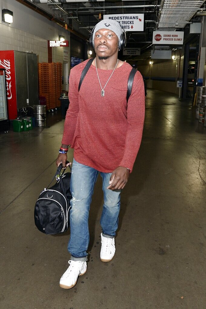 FILE- In this Oct. 25, 2015 file photo, Atlanta Falcons defensive back Phillip Adams arrives for an NFL football game against the Tennessee Titans, in Nashville, Tenn. The gunman who killed multiple people including a prominent doctor in South Carolina was the former NFL pro, who killed himself early Thursday, April 8, 2021, according to a source who was briefed on the investigation. (AP Photo/Mark Zaleski, File)