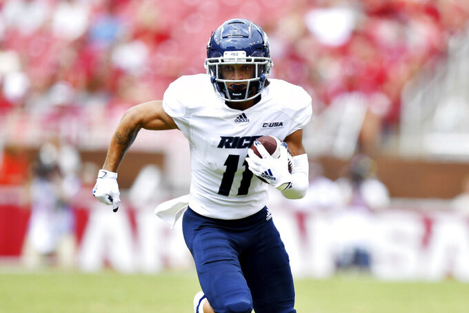 Rice receiver Jake Bailey (11) runs for a gain against Arkansas during the first half of an NCAA college football game Saturday, Sept. 4, 2021, in Fayetteville, Ark. (AP Photo/Michael Woods)