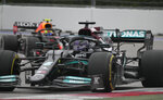 Mercedes driver Lewis Hamilton of Britain steers his car during the Russian Formula One Grand Prix at the Sochi Autodrom circuit, in Sochi, Russia, Sunday, Sept. 26, 2021. (AP Photo/Sergei Grits)