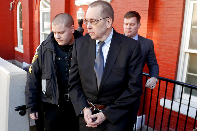 David Lee Poulson, center, a Roman Catholic priest who pleaded guilty to sexually abusing two boys, is taken away from court after sentencing on Friday, Jan. 11, 2019 in Brookville, Pa. Poulson is one of two priests charged as a result of a damning Pennsylvania grand jury report that named almost 300 predator priests accused abusing more than 1,000 victims in six of the state's dioceses.(AP Photo/Keith Srakocic)