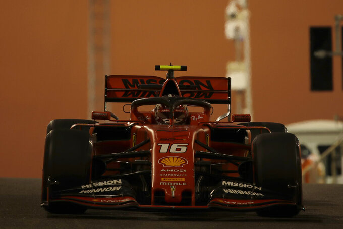 Ferrari driver Charles Leclerc of Monaco steers his car during the second free practice at the Yas Marina racetrack in Abu Dhabi, United Arab Emirates, Friday, Nov. 29, 2019. The Emirates Formula One Grand Prix will take place on Sunday. (AP Photo/Luca Bruno)