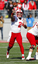 Nebraska quarterback Adrian Martinez throws a pass against Ohio State during the first half of an NCAA college football game Saturday, Nov. 3, 2018, in Columbus, Ohio. (AP Photo/Jay LaPrete)