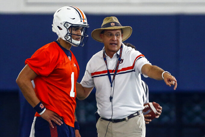 Quarterback Joey Gatewood gets some instruction from coach Gus Malzahn during Auburn's first practice, Friday, Aug. 2, 2019, in Auburn, Ala. (AP Photo/Butch Dill)