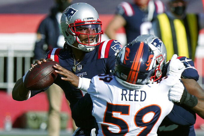 New England Patriots quarterback Cam Newton, right, passes under pressure from Denver Broncos linebacker Malik Reed (59) in the second half of an NFL football game, Sunday, Oct. 18, 2020, in Foxborough, Mass. (AP Photo/Steven Senne)