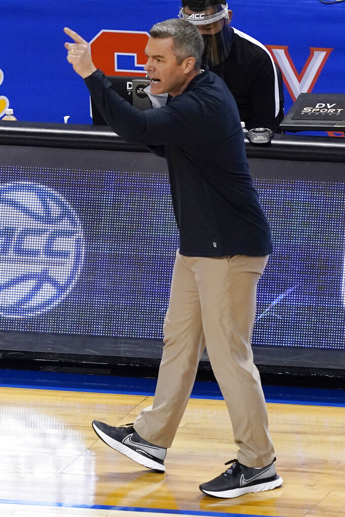 Virginia head coach Tony Bennett directs his team during the second half of an NCAA college basketball game against Syracuse in the quarterfinal round of the Atlantic Coast Conference tournament in Greensboro, N.C., Thursday, March 11, 2021. (AP Photo/Gerry Broome)