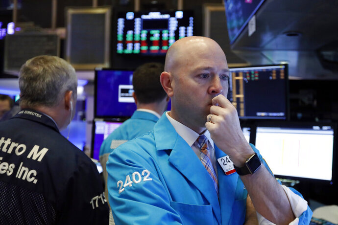 Specialist Jay Woods works at his post on the floor of the New York Stock Exchange, Thursday, Feb. 6, 2020. U.S. stocks rose in midday trading Thursday as investors continued focusing on the latest round of corporate earnings and China cut tariffs on key imports as part of a trade war truce. (AP Photo/Richard Drew)