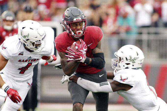 Eastern Washington defensive back Mitch Fettig (4) and defensive back Josh Lewis, right, tackle Washington State wide receiver Davontavean Martin during the first half of an NCAA college football game in Pullman, Wash., Saturday, Sept. 15, 2018. (AP Photo/Young Kwak)