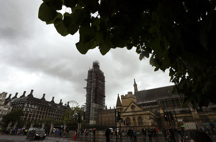 Clouds above Britain's Parliament in London, Friday, Sept. 27, 2019. U.K. interest rates could be cut even if the country avoids leaving the European Union on Oct. 31 without a deal, one of the Bank of England's nine top policymakers said Friday. (AP Photo/Kirsty Wigglesworth)