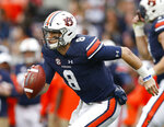 FILE - In this Nov. 25, 2017, file photo, Auburn quarterback Jarrett Stidham (8) runs the ball during the first half of the Iron Bowl NCAA college football game against Alabama, in Auburn, Ala. Potential Heisman Trophy contender Stidham will lead No. 9 Auburn against No. 6 Washington in the only opening-week game between top-10 teams. (AP Photo/Brynn Anderson, File)