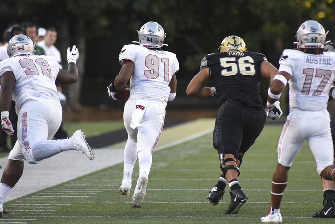 UNLV defensive end Nate Neal (91) returns a fumble past Vanderbilt lineman Saige Young (56) in the second half of an NCAA college football game Saturday, Oct. 12, 2019, in Nashville, Tenn. (AP Photo/Mike Strasinger)