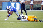 Duke's Quentin Harris (18) is pulled down by North Carolina A&T's Derrek Williams (21) during the first half of an NCAA college football game in Durham, N.C., Saturday, Sept. 7, 2019. (AP Photo/Karl B DeBlaker)