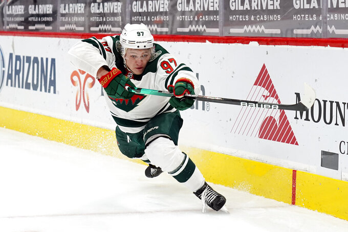 FILE - Minnesota Wild left wing Kirill Kaprizov (97) plays in the first period during an NHL hockey game against the Arizona Coyotes in Glendale, Ariz., in this Friday, March 5, 2021, file photo. After waiting five years for Kirill Kaprizov to leave Russia for the NHL, the Minnesota Wild's level of satisfaction with their floppy-haired, easy-smiling left wing has met the extraordinary expectations that surrounded his debut season. (AP Photo/Rick Scuteri, File)