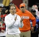 Alabama head coach Nick Saban and Clemson head coach Dabo Swinney watch warm ups before the NCAA college football playoff championship game Monday, Jan. 7, 2019, in Santa Clara, Calif. (AP Photo/David J. Phillip)