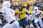 West Virginia quarterback Austin Kendall (12) runs the ball during the second half of an NCAA college football game against Texas, Saturday, Oct. 5, 2019, in Morgantown, W.Va. (AP Photo/Raymond Thompson)