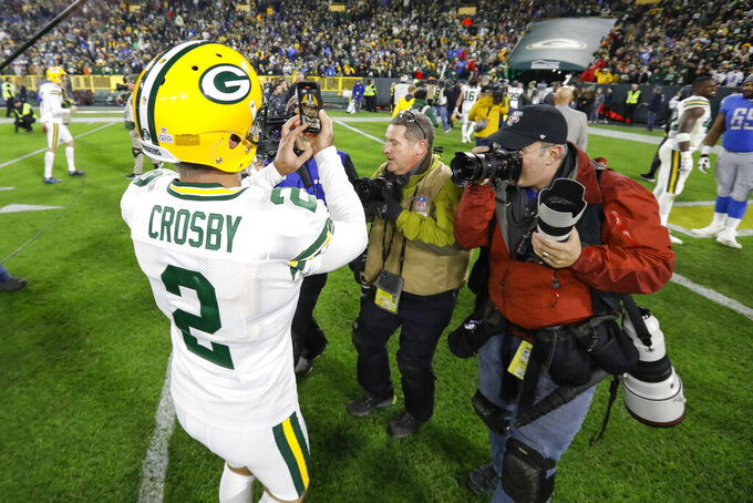 Green Bay Packers kicker Mason Crosby takes a selfie as he walks off the field following an NFL football game against the Detroit Lions, Monday, Oct. 14, 2019, in Green Bay, Wis. Green Bay won 23-22. (AP Photo/Mike Roemer)