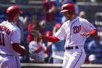 Washington Nationals Trea Turner, right, celebrates his solo home run with Ryan Zimmerman during the third inning of a baseball game against the Arizona Diamondbacks at Nationals Park, Sunday, April 18, 2021, in Washington. (AP Photo/Alex Brandon)