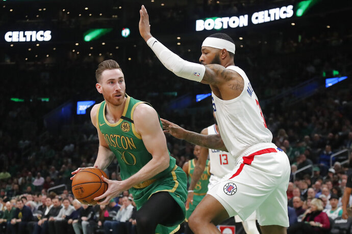 Boston Celtics forward Gordon Hayward (20) looks for room to shoot against Los Angeles Clippers forward Marcus Morris Sr., right, in the first half of an NBA basketball game, Thursday, Feb. 13, 2020, in Boston. (AP Photo/Elise Amendola)