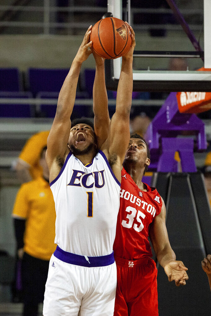 East Carolina's Jayden Gardner (1) and Houston's Fabian White Jr. (35) battle for a rebound during the second half of an NCAA college basketball game in Greenville, N.C., Wednesday, Feb. 27, 2019. (AP Photo/Ben McKeown)