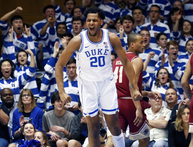 Duke's Marques Bolden (20) celebrates after he dunked against Boston College during the first half of an NCAA college basketball game in Durham, N.C., Tuesday, Feb. 5, 2019. (AP Photo/Chris Seward)