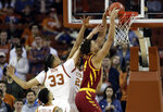 Iowa State forward George Conditt IV (4) scores past Texas forward Kamaka Hepa (33) and forward Jericho Sims (20) during the second half of an NCAA college basketball game, Saturday, March 2, 2019, in Austin, Texas. (AP Photo/Eric Gay)