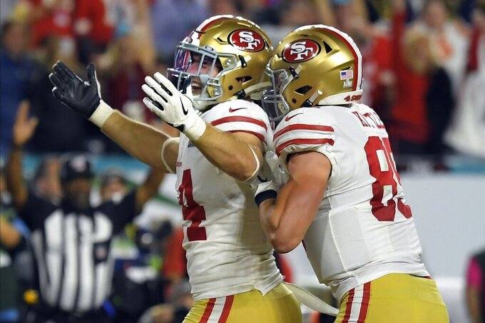 San Francisco 49ers' Kyle Juszczyk, left, celebrates his touchdown during the first half of the NFL Super Bowl 54 football game against the Kansas City Chiefs Sunday, Feb. 2, 2020, in Miami Gardens, Fla. (AP Photo/Mark J. Terrill)