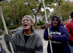 Carolyn Nicholson, left, and Rochelle Mitchell chant during a protest against the execution of Rodney Reed on Wednesday, Nov. 13, 2019, in Bastrop, Texas. Reed is scheduled to be executed Nov. 20, but a growing number of politicians and celebrities have joined calls to further examine Reed's case before his execution proceeds. (Nick Wagner/Austin American-Statesman via AP)