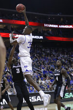 Seton Hall's Romaro Gill (35) dunks the ball in front of Providence's David Duke (3) during the second half of an NCAA college basketball game Wednesday, Jan. 22, 2020, in Newark, N.J. Seton Hall won 73-64. (AP Photo/Frank Franklin II)