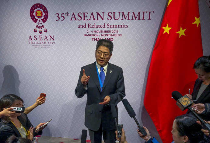 Chinese Vice Foreign Minister Le Yucheng speaks to reporters during ASEAN summit in Nonthaburi, Thailand, Monday, Nov. 4, 2019. (AP Photo/Johnson Lai )