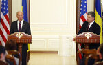 """FILE - In this Jan. 16, 2017, file photo Vice President Joe Biden, left, and Ukrainian President Petro Poroshenko give a joint statement to the press in Kiev, Ukraine. The leaked recordings of apparent conversations between Joe Biden and Ukraine's then-president largely confirm Biden's account of his dealings in Ukraine. The choppy audio, disclosed by a Ukrainian lawmaker whom U.S. officials described Thursday, Sept. 10, 2020, as an """"active Russian agent"""" who has sought to spread online misinformation about Biden. (AP Photo/Sergei Chuzavkov, File)"""