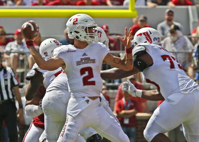 Florida Atlantic quarterback Chris Robison (2) throws in the first half of an NCAA college football game against Oklahoma in Norman, Okla., Saturday, Sept. 1, 2018. (AP Photo/Sue Ogrocki)