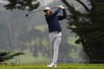 Tom Fleetwood of England, watches his tee shot on the fourth hole during the third round of the PGA Championship golf tournament at TPC Harding Park Saturday, Aug. 8, 2020, in San Francisco. (AP Photo/Jeff Chiu)