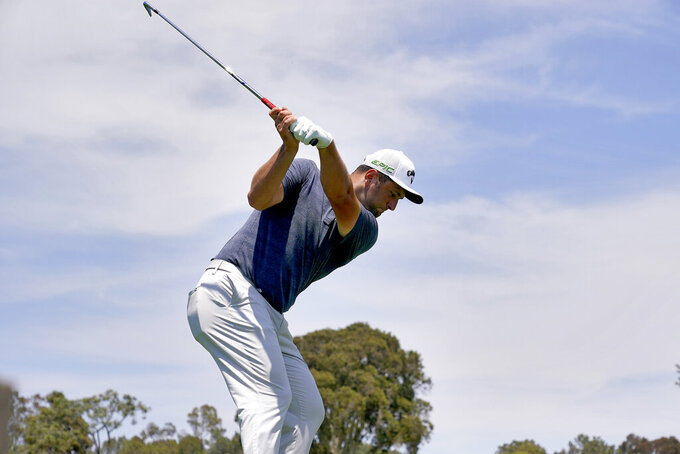 Jon Rahm, of Spain, plays his shot from the eighth tee during a practice round of the U.S. Open Golf Championship, Tuesday, June 15, 2021, at Torrey Pines Golf Course in San Diego. (AP Photo/Gregory Bull)
