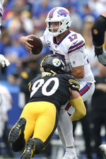 Buffalo Bills quarterback Josh Allen (17) is sacked by Pittsburgh Steelers outside linebacker T.J. Watt during the second half of an NFL football game in Orchard Park, N.Y., Sunday, Sept. 12, 2021. (AP Photo/Joshua Bessex)