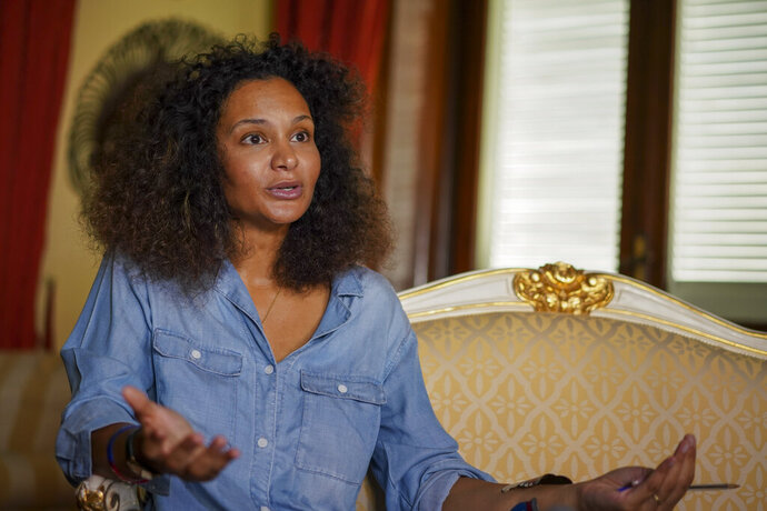 FILE - In this Aug. 13, 2020 file photo, fashion designer Stella Jean talks during an interview with the Associated Press, in Rome. A digital runway show by five Italian fashion designers of African origin opens Milan Fashion Week on Wednesday, Feb. 24, 2020, one tangible result of a campaign launched last summer by the only Black Italian designer belonging to the Italian fashion chamber.  (AP Photo/Andrew Medichini, file)