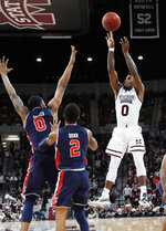 Mississippi State guard Nick Weatherspoon (0) attempts a three-point basket in front of Auburn forward Horace Spencer (0) and guard Bryce Brown (2) during the first half of an NCAA college basketball game in Starkville, Miss., Saturday, Jan. 26, 2019. (AP Photo/Rogelio V. Solis)