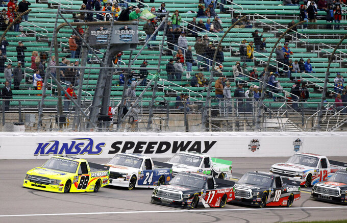 Drivers take the green flag at the start of the NASCAR Truck Series auto race at Kansas Speedway in Kansas City, Kan., Friday, May 10, 2019. (AP Photo/Colin E. Braley)