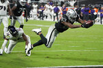 Las Vegas Raiders tight end Darren Waller (83) dives into the end zone for a touchdown against the Baltimore Ravens during the second half of an NFL football game, Monday, Sept. 13, 2021, in Las Vegas. (AP Photo/Rick Scuteri)