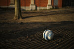 FILE - In this Thursday, March 19, 2020 file photo, a soccer ball lays on the playground of a closed primary school in Brussels. The European Union's external auditor said Tuesday, Sept. 29, 2020 that child poverty has reached worrying levels across the world's largest economy, and has become an unacceptable situation likely to worsen during the coronavirus pandemic. (AP Photo/Francisco Seco, File)